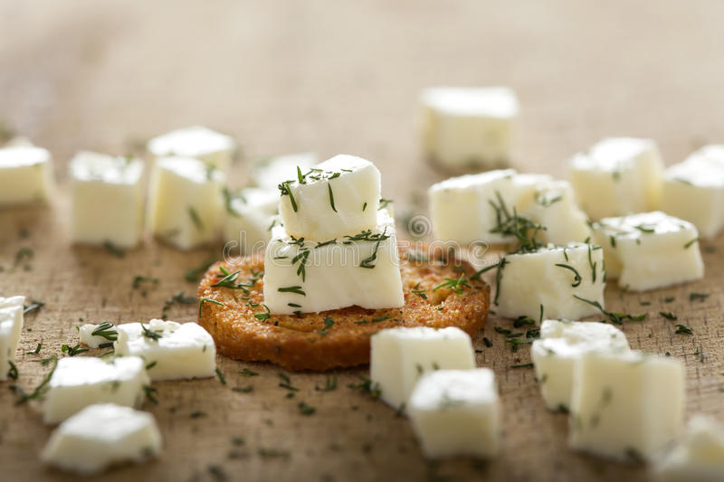 Antipasto with cheese and dill. Close up of one antipasto with cheese and dill over wood background royalty free stock photos