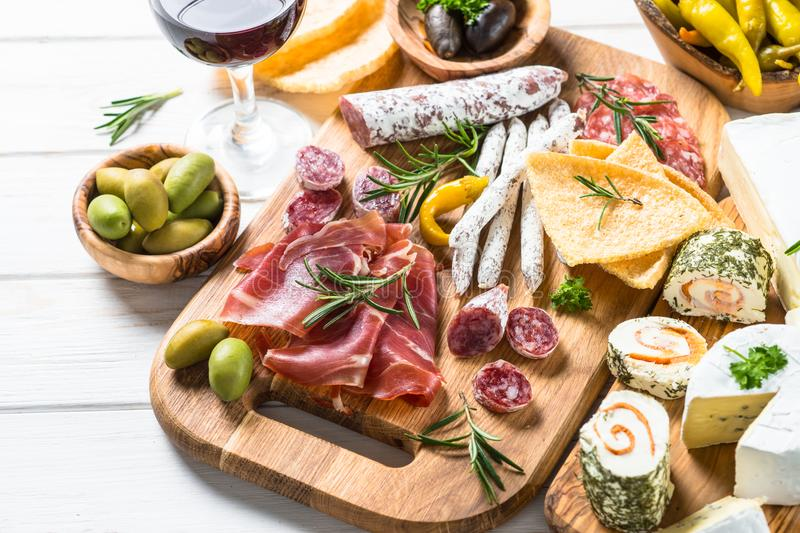 Antipasto delicatessen - meat, cheese and wine. Antipasto delicatessen - sliced meat, ham, salami, cheese, olives ciabatta and red wine stock photos