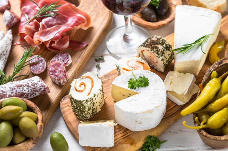 Antipasto delicatessen - meat, cheese and wine. Antipasto delicatessen - sliced meat, ham, salami, cheese, olives ciabatta and red wine royalty free stock images