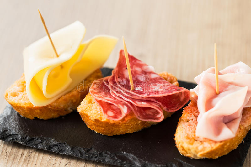Antipasto. Food with cheese, salami, and tork ham with breadsticks royalty free stock image