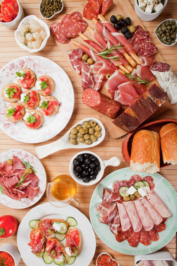 Antipasto food. Table full of antipasto or tapas, appetizer food stock photo
