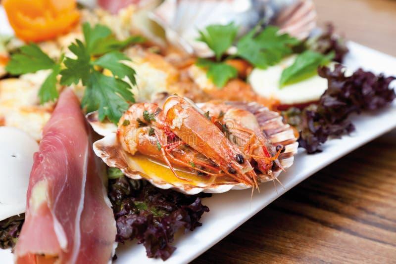 Antipasto,Gambas al Ajillo,herring fillet,cured ham stock images
