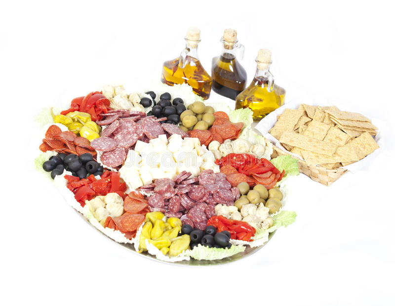 Antipasto. Isolated Antipasto with oils and crackers royalty free stock photography