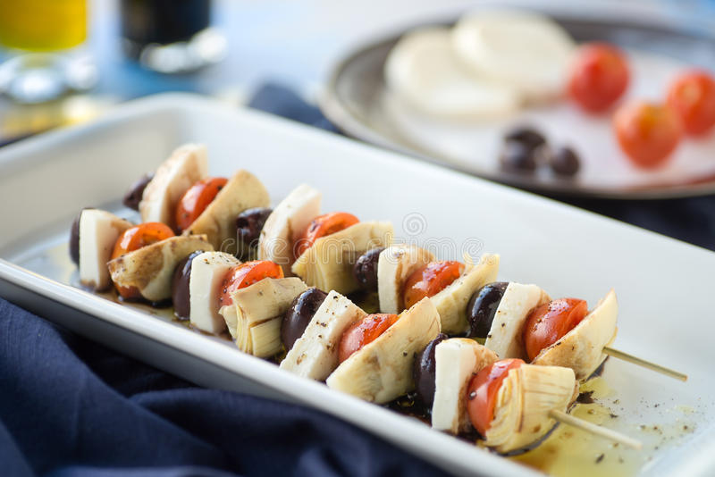 Antipasto Kebobs. Vegetarian antipasto kepbobs drizzled with olive oil and balsamic vinegar royalty free stock image