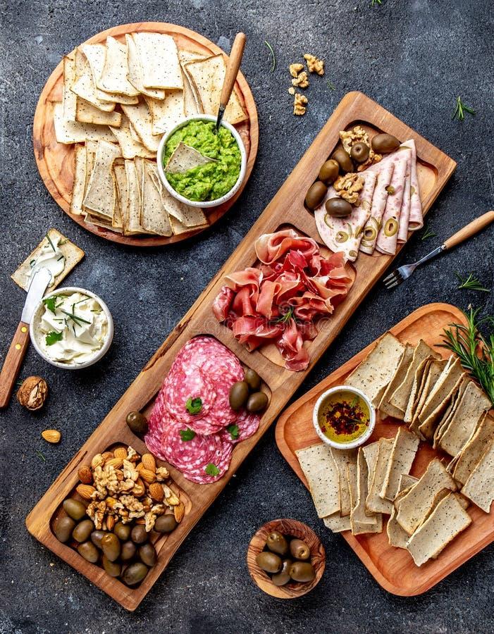 Antipasto Platter. Ham serrano, salami olive jamon dip sauces and red wine. Top view royalty free stock photos