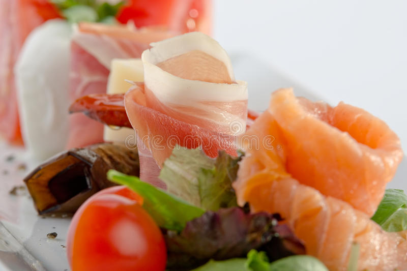 Antipasto. With salmon and prosciutto - isolated royalty free stock photos