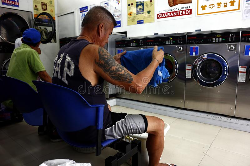 Tập Truyện Ngắn: Người ở lại thế gian  Antipolo-city-philippines-december-customers-laundromat-sit-wait-their-clothes-to-be-finished-washing-customers-167847178