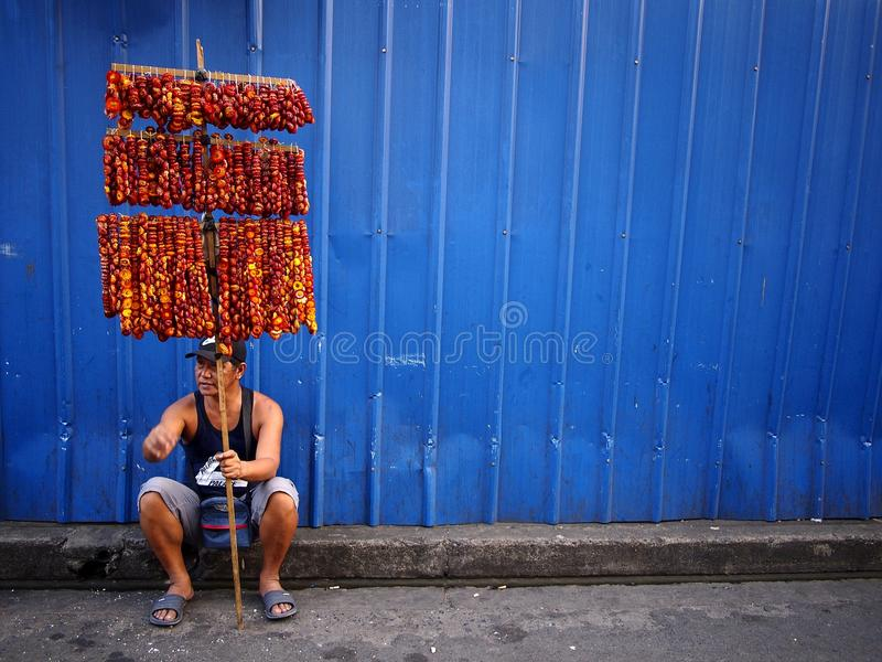 A street vendor sells colorful garlands of dried Everlasting flowers. stock photo