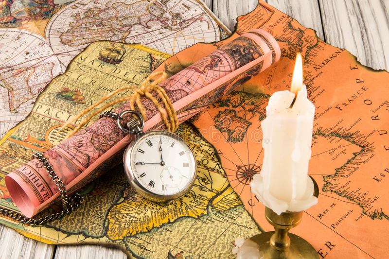 Antiquarian pocket watch. And ancient world maps royalty free stock photos