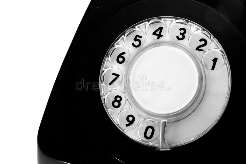 Antiquated phone. In a white background stock photo