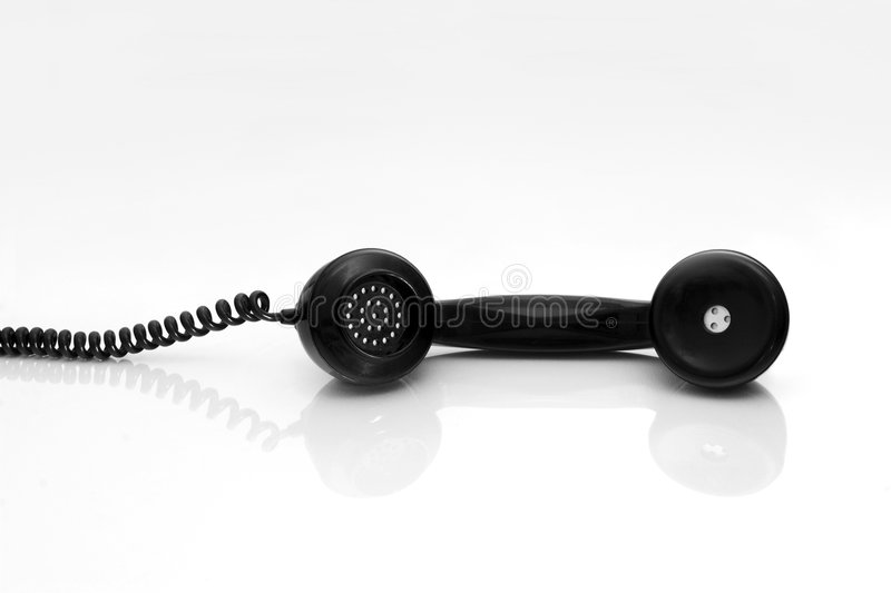 Antiquated phone. With reflection in a white background stock photos