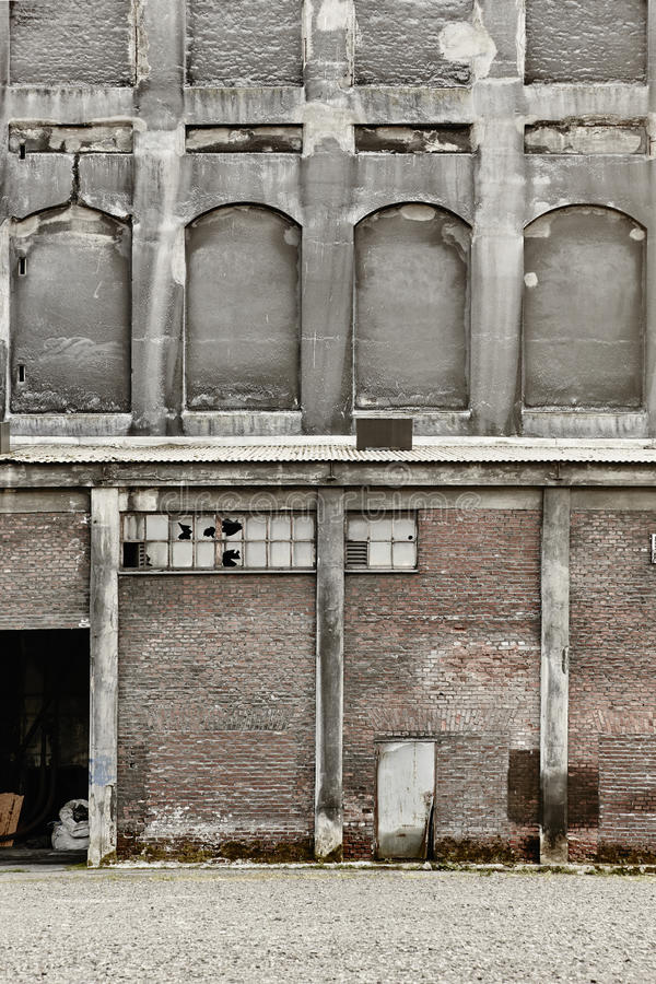 Antique abandoned brick and concrete warehouse facade. Norway. Old architecture royalty free stock photography