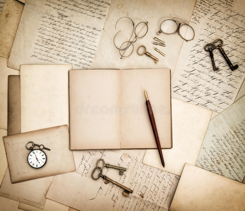 Antique accessories, old letters, pocket watch and keys. Vintage stock photo