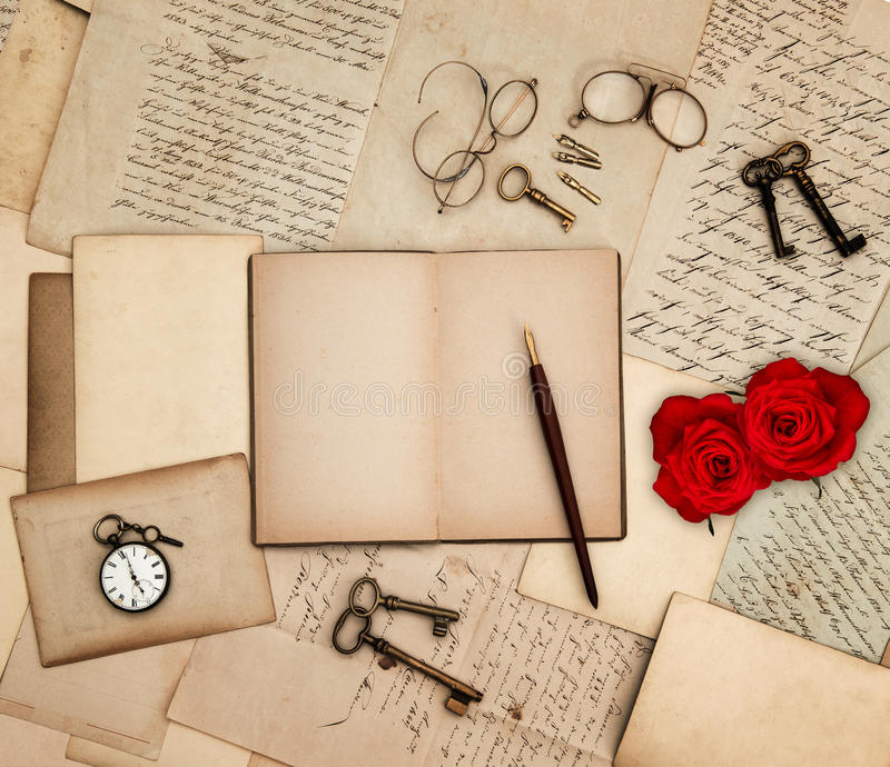 Antique accessories, old letters, watch, red rose. Flowers and keys. sentimental nostalgic background royalty free stock photo