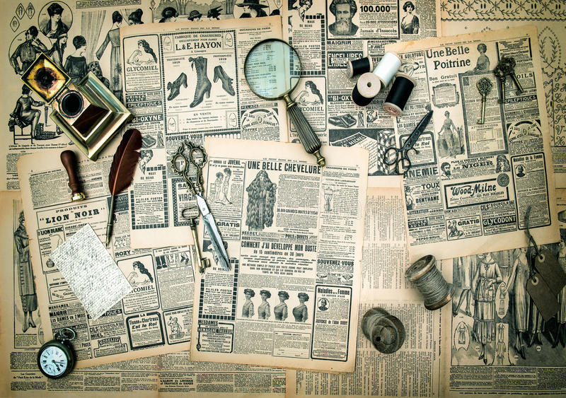 Antique accessories, vintage fashion newspaper advertising royalty free stock images
