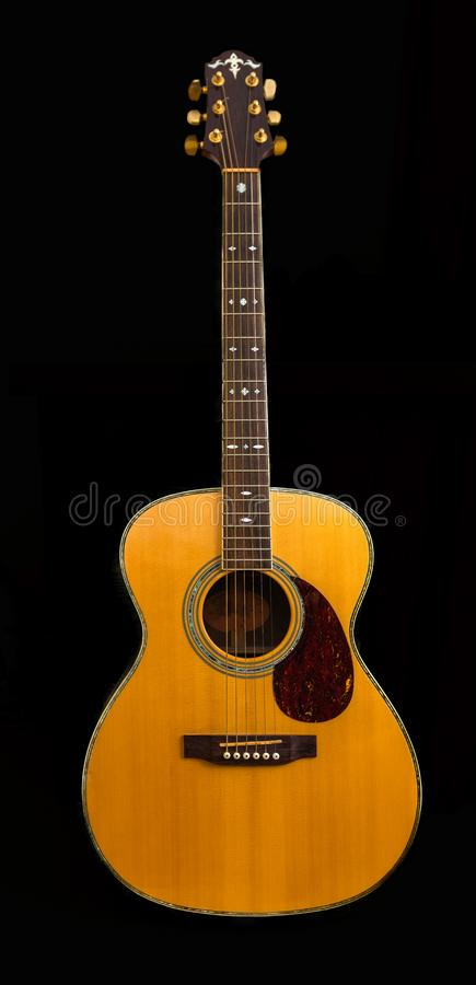 Antique Accoustic Guitar Yellow Spruce Top small pick guard all isolated on a black background. Ancient accoustic guitar ouned by the contributor make not known royalty free stock images
