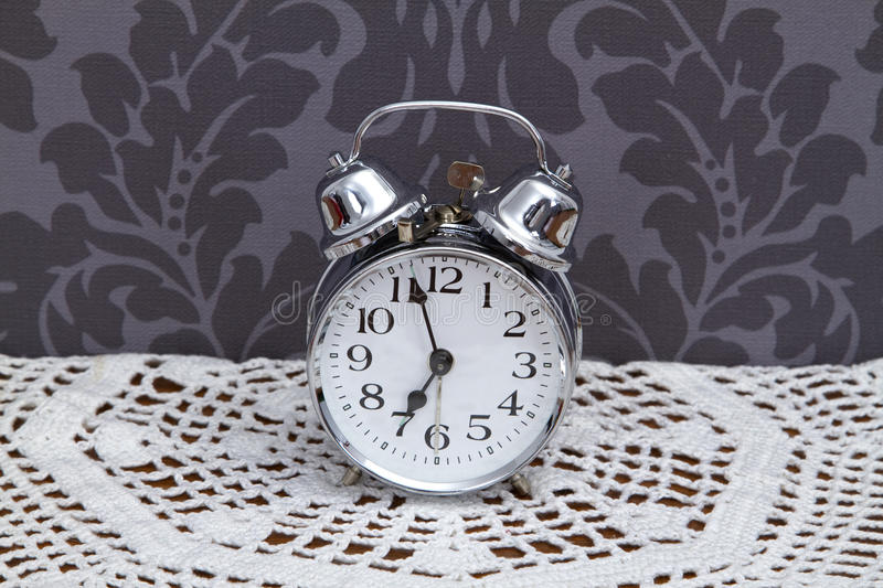 Download Antique Alarm Clock On Table Cloth Stock Photo - Image: 26674720