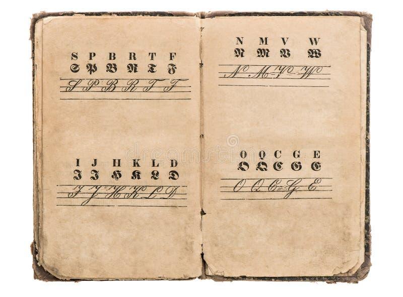 Antique alphabet book. vintage fonts. education concept. Antique alphabet book on white background. vintage fonts on aged paper. education concept stock photo