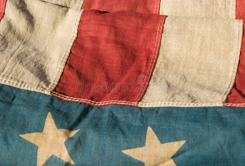 Antique american flag. Close up of a section of an antique american flag stock photos