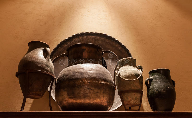 Antique arabian brass jar and pots royalty free stock photos