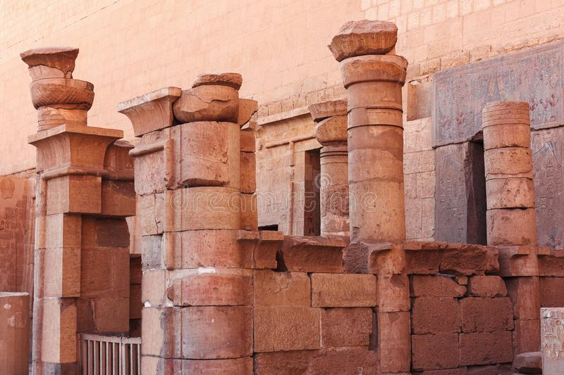 Antique architecture in Ancient Egyptian temple complex. Antique architecture with stone columns in in Ancient Egyptian temple complex royalty free stock photography