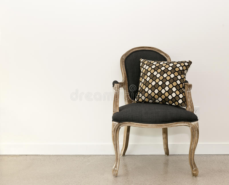 Download Antique armchair near wall stock photo. Image of seat - 26857174