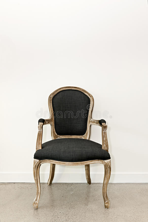 Download Antique Armchair Near Wall Royalty Free Stock Photography - Image: 26857187