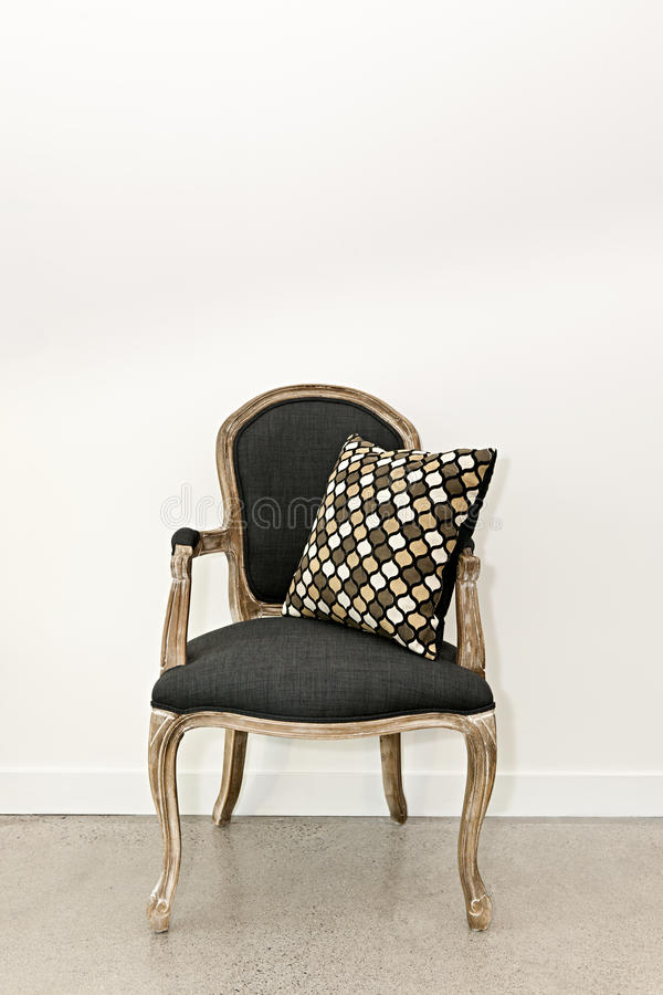 Antique Armchair Near Wall Stock Images