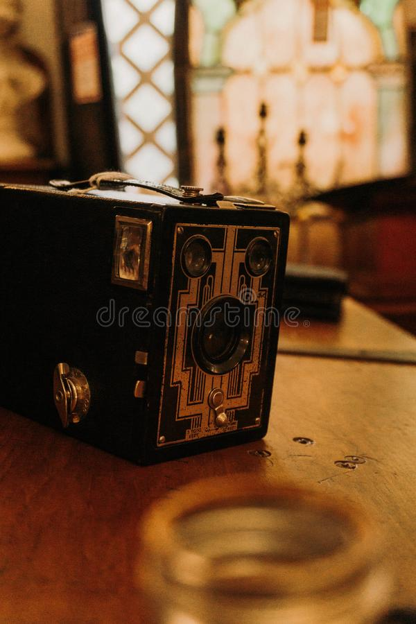 Antique art deco box camera. Antique art deco style box camera surrounded by timeless forgotten treasures royalty free stock photo