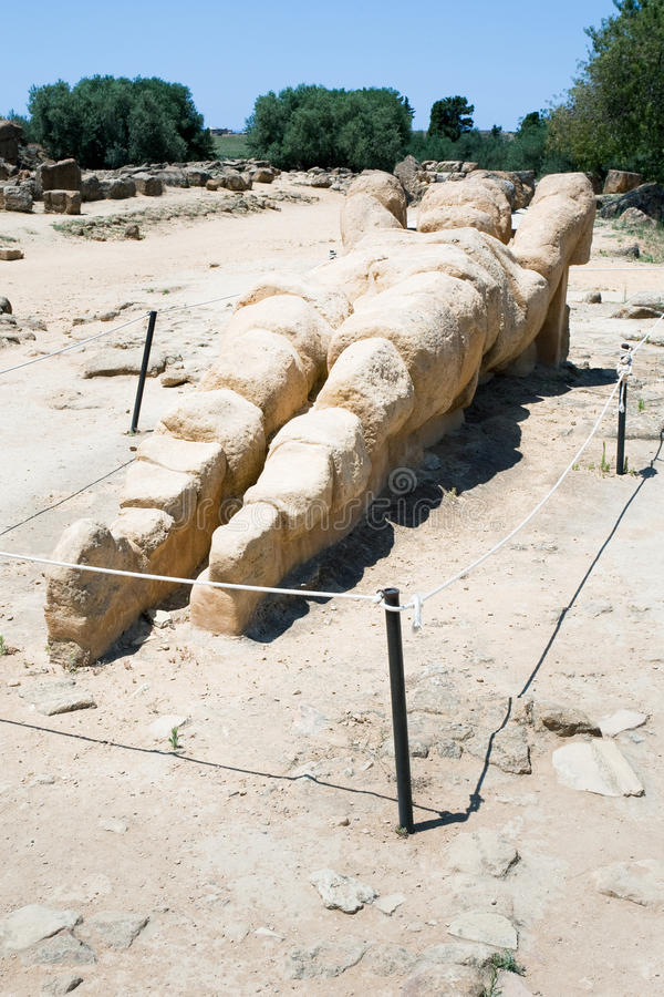 Antique Atlant sculpture in Valley of the Temples. Agrigento, Sicily royalty free stock image