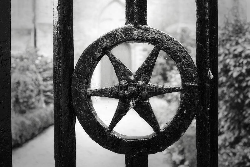 Antique and authentic iron cast gate royalty free stock photos