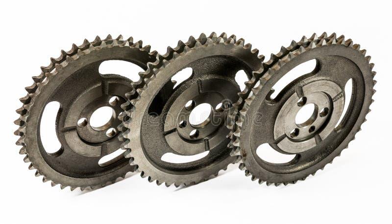 Antique automotive cast iron timing gears. Antique automotive double roller cast iron timing gears stock photo