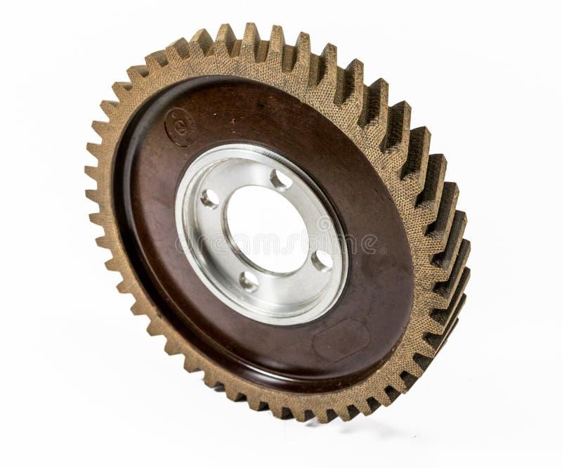 Antique automotive fiber camshaft timing gear. On edge stock images