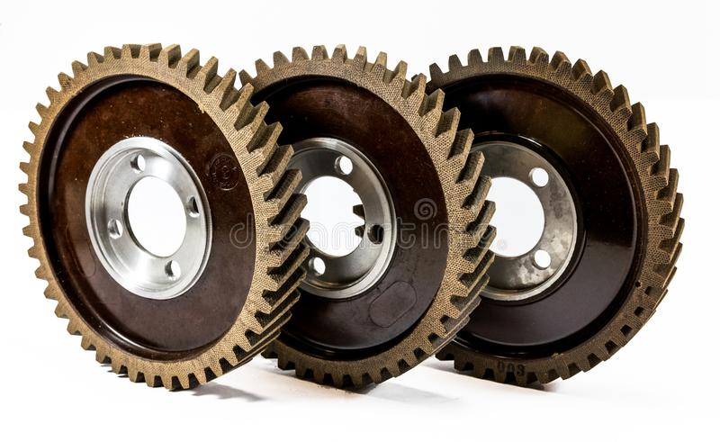 Antique automotive fiber camshaft timing gears. On edge stock image