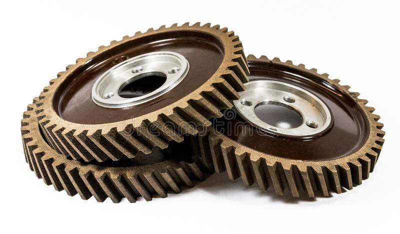 Antique automotive fiber camshaft timing gears stacked. On side stock photography