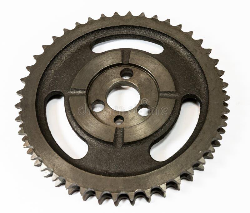 Antique automotive iron timing gear. Antique automotive double roller cast iron timing gear stock images
