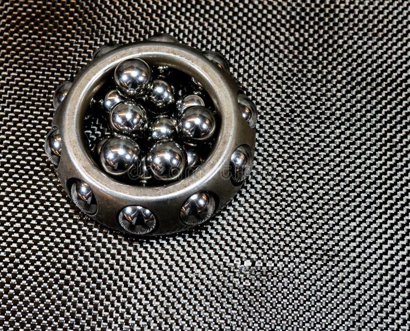 Antique automotive wheel bearing on carbon fiber royalty free stock photo