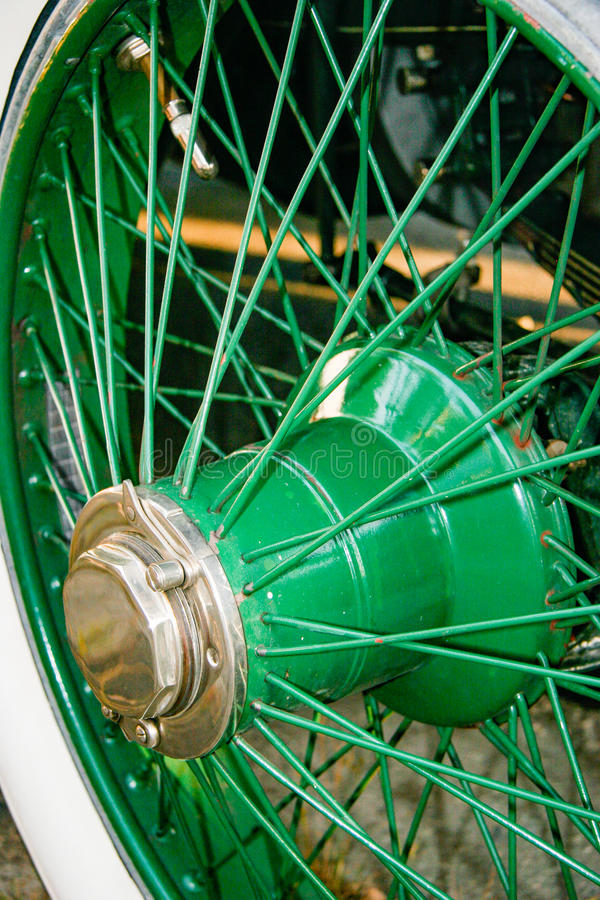 Antique automotive wheel with green spokes royalty free stock images