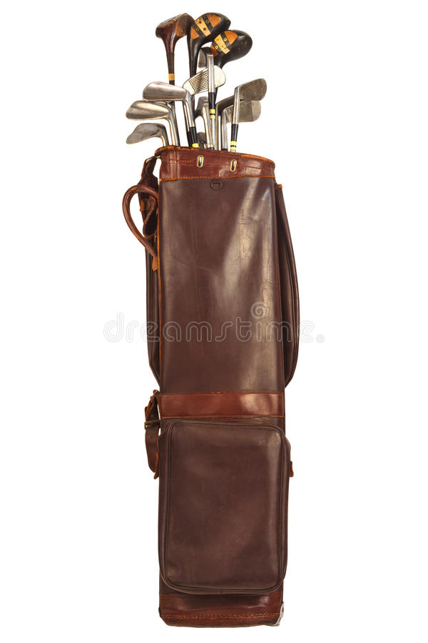 Antique bag with golf clubs isolated on white. Antique brown leather bag with steel and wooden golf clubs isolated on a white background royalty free stock images