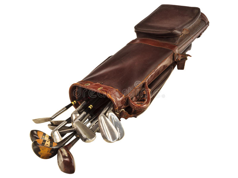Antique bag with golf clubs isolated on white. Antique brown leather bag with steel and wooden golf clubs isolated on a white background stock photo