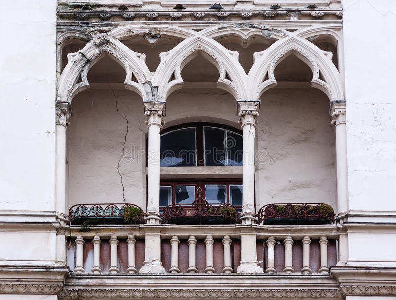 Antique balcony in the Gothic style on a building facade royalty free stock photography