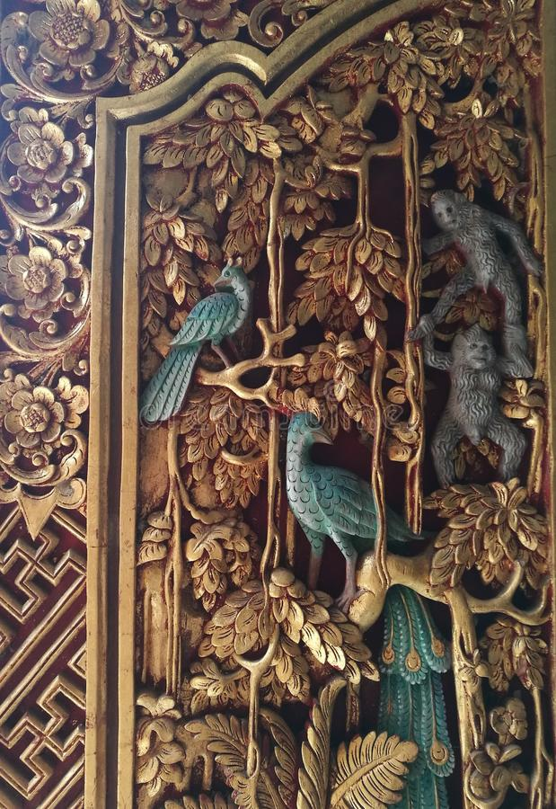 Antique Balinese ornate carved wood door royalty free stock photography