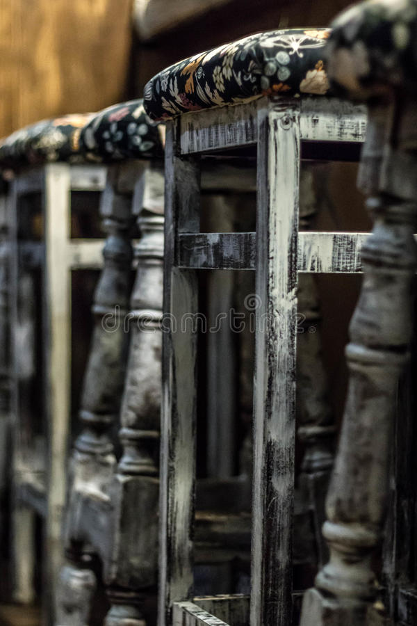 Antique bar stools royalty free stock images