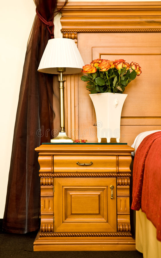 Antique bedside table royalty free stock photo