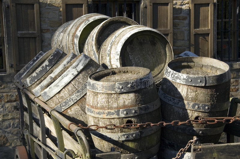 Antique beer barrels. Draft beer on a hay cart in front of the brewery stock photo