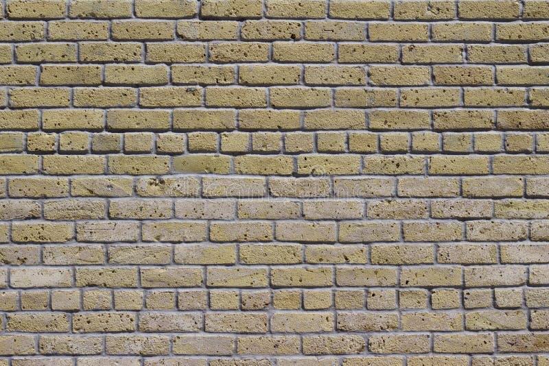 Antique beige brick wall texture in common bond brickwork pattern royalty free stock image