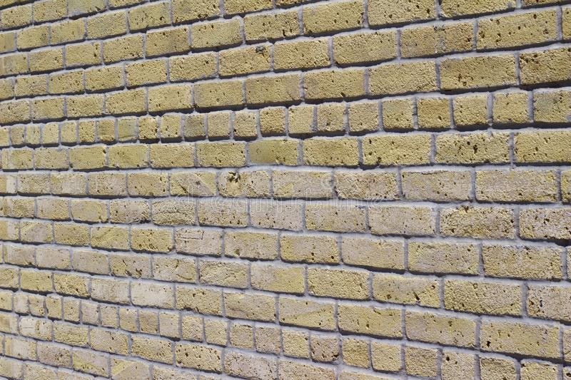 Antique beige brick wall texture in common bond brickwork pattern. Antique rustic looking yellow beige brick wall texture in a common bond brickwork pattern royalty free stock photos