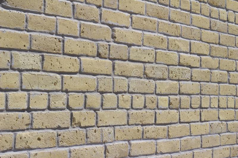Antique beige brick wall texture in common bond brickwork pattern stock photo