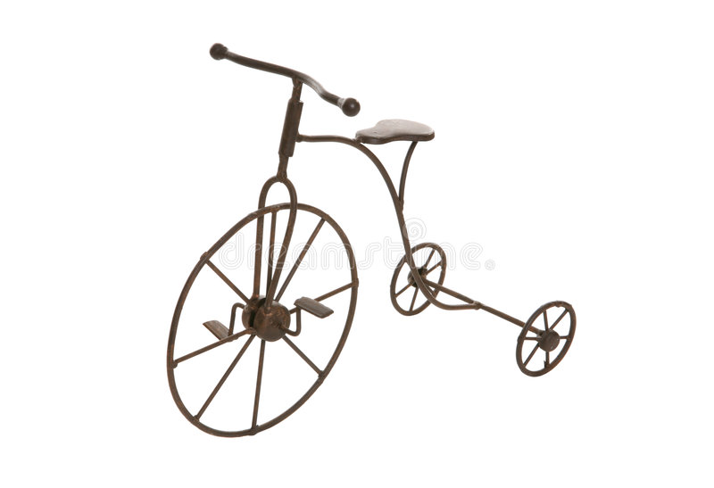 Antique Bike. An antique bicycle isolated over a white background royalty free stock images