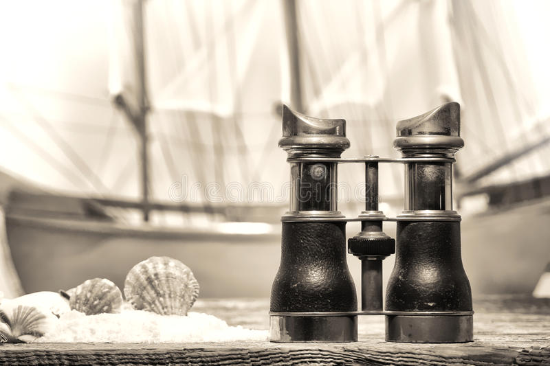 Antique Binocular on Old Wood Pier at the Shore stock image